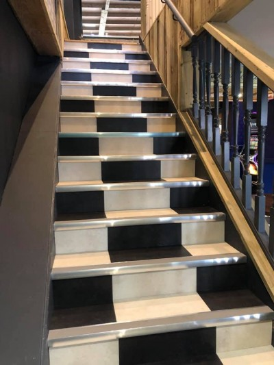 Karndean Opus Vinyl Flooring fitted on staircase in Newton Abbot Restaurant in a black and white checkerboard effect
