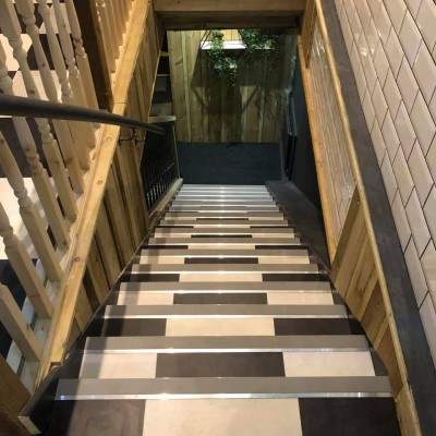 Karndean Opus Vinyl Flooring fitted on stairs in Newton Abbot Restaurant in a black and white checkerboard effect