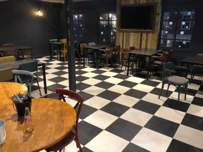 Karndean Opus Vinyl Flooring fitted in Newton Abbot Restaurant in a black and white checkerboard effect