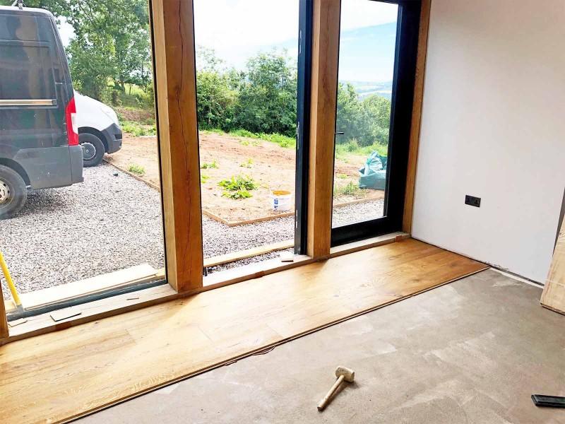 Fitting wooden floor to under floor heating