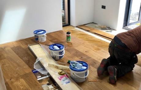 Tradesman installing Wood flooring